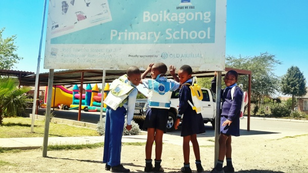 Photo Credit: Pupils from Boikagong Primary School wearing Repurposed Schoolbags (N.D) Retrieved 12/20/2015 from http://www.repurposeschoolbags.com/anatomyofaschoolbag/