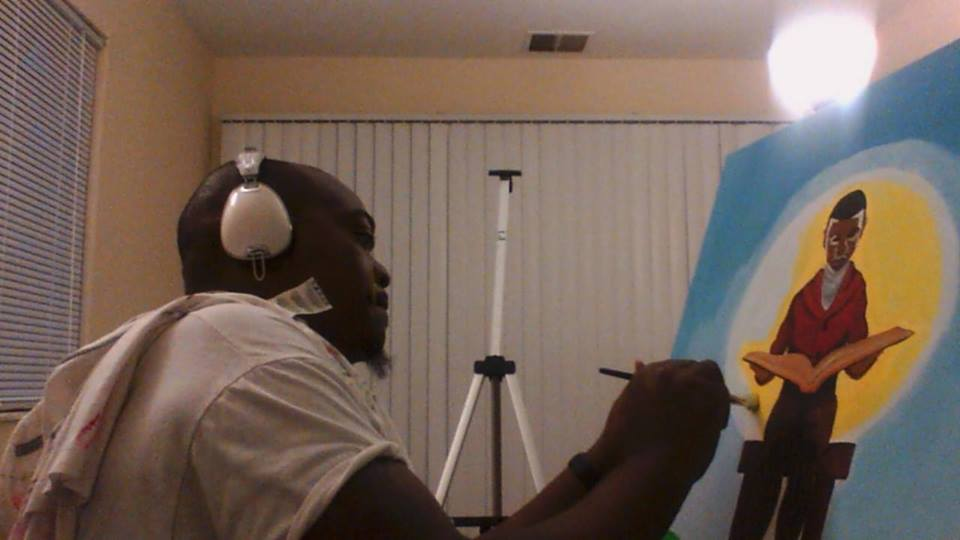 Andre painting art for a client. Image Courtesy of Andre Williams