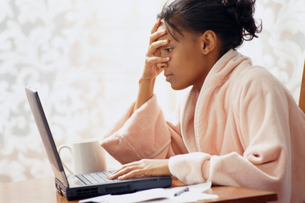 Frustrated Woman Using Laptop ca. 2002